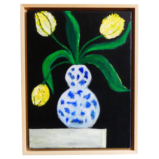 Yellow tulips in Delft blue vase