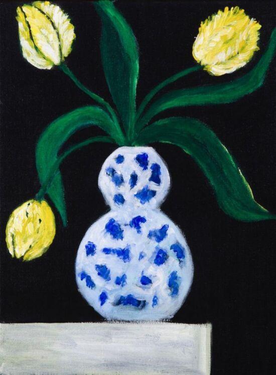 Yellow tulips in Delft blue vase