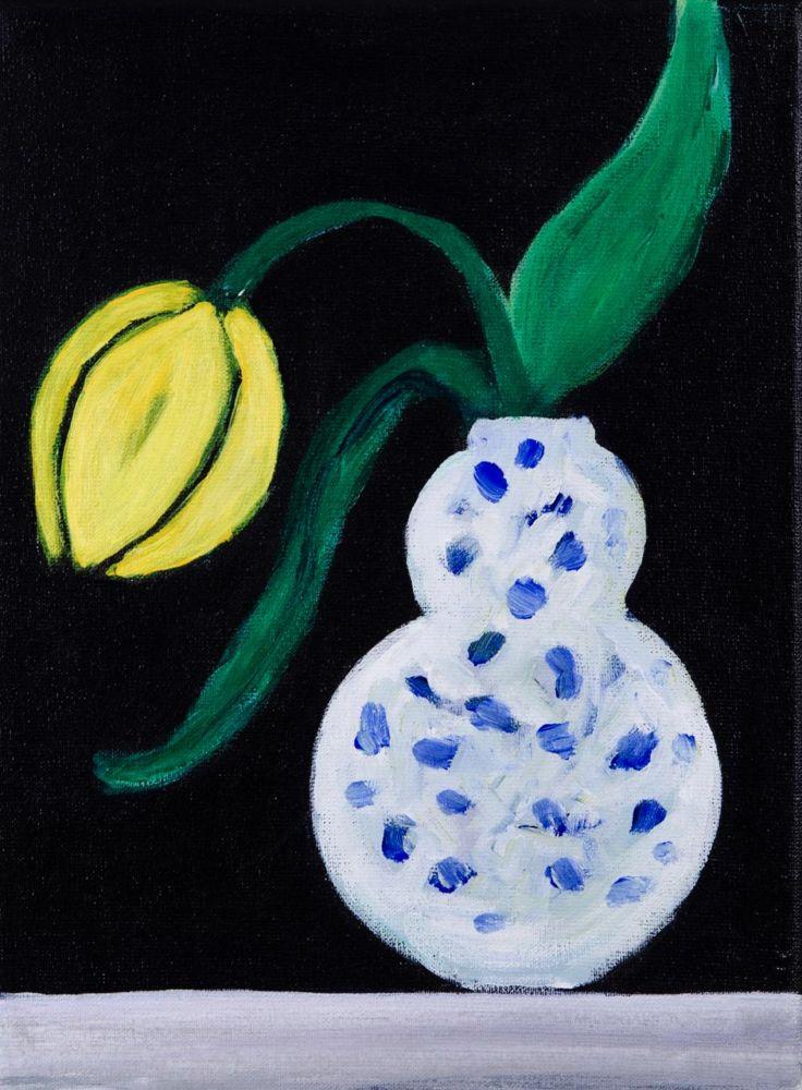 Yellow tulip in Delft blue vase